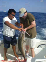 helping fishing crew- charter fishing cancun